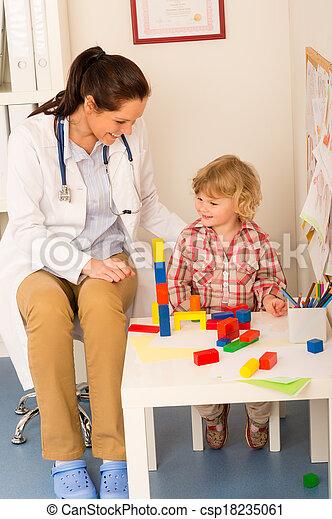 Visit at pediatrician child girl playing - csp18235061