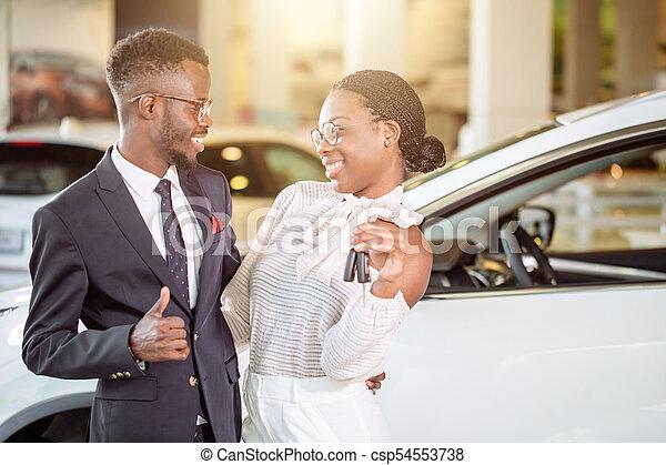 Key Car Dealership >> Visiting Car Dealership Couple Holding Key Of Their New Car Looking At Camera