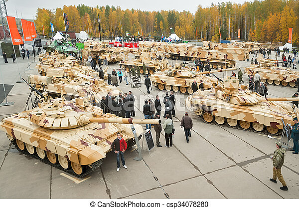Visitors explore military vehicles on exhibition - csp34078280