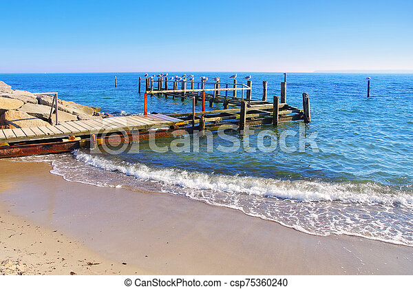 Vitt with wooden jetty near Kap Arkona, Ruegen Island in Germany - csp75360240