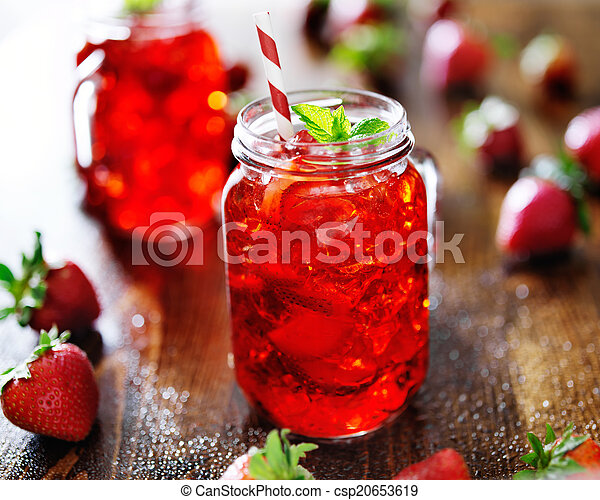 vivid red strawberry cocktail in a jar - csp20653619