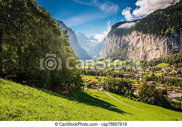 Vivid view of alpine village. Location place Swiss alps, Lauterbrunnen valley. - csp78807619