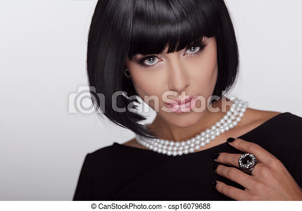 Vogue style. Fashion Haircut. Hairstyle. Sexy Lady. Stylish Fringe. Short Hair Style. Brunette woman with jewelry pearls  - csp16079688