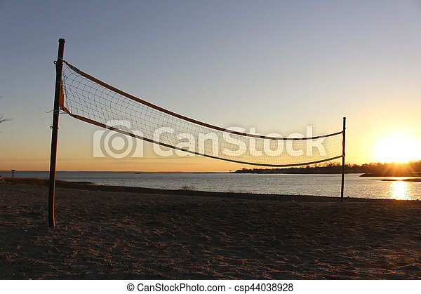 Volleyball net on beach at sunset - csp44038928