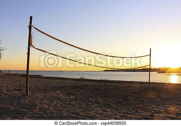 Volleyball net on beach at sunset - csp44038930