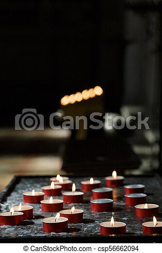 Votos con velas de fondo - csp56662094