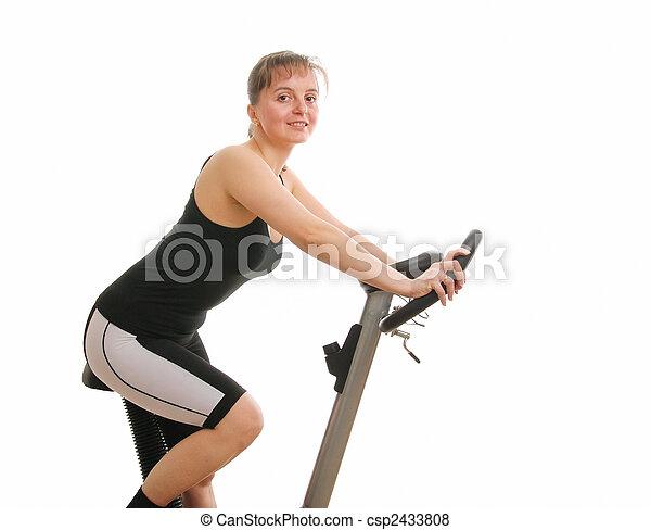 vrouw, fiets, -, back, vrijstaand, het spinnen, fitness, het uitoefenen - csp2433808