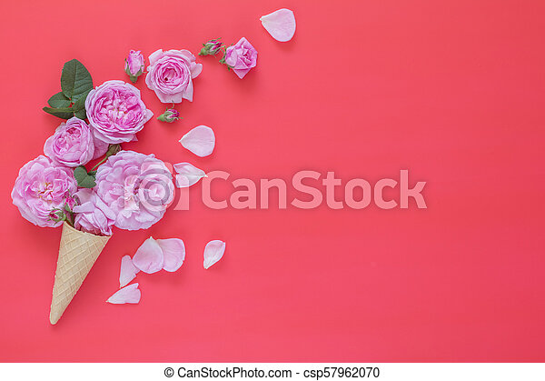 Waffle cone with pink roses flower bouquet on pink background - csp57962070