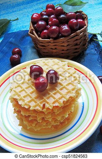 waffles and fruit, strawberries and cherries - csp51824563