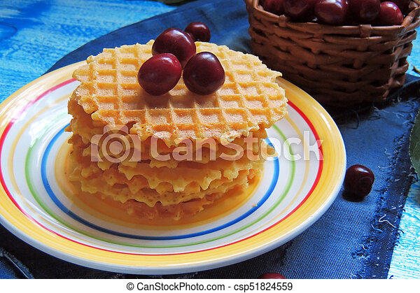 waffles and fruit, strawberries and cherries - csp51824559