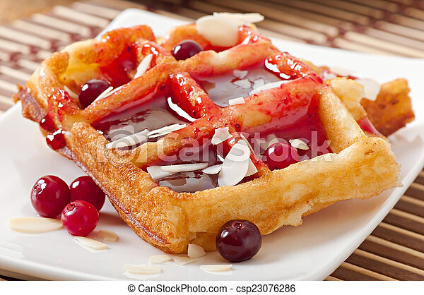 waffles with cranberry syrup - csp23076286