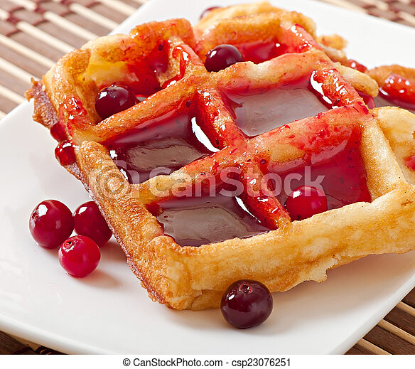 waffles with cranberry syrup - csp23076251