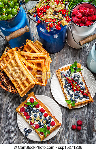 Waffles with fresh collected berry fruit - csp15271286