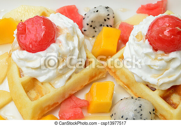 waffles with fresh fruits and cream - csp13977517