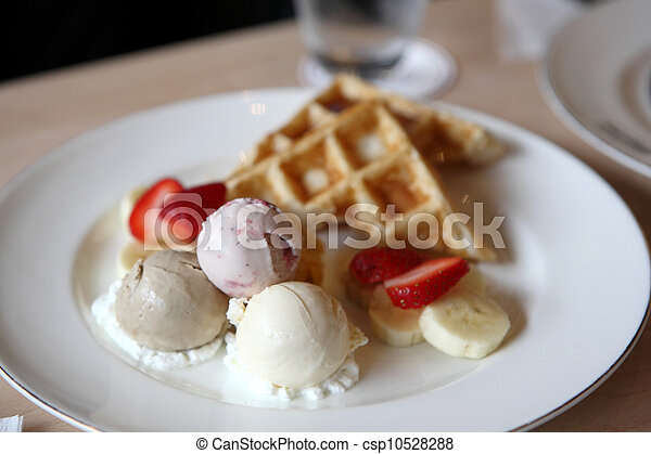 Waffles with ice cream and fruits - csp10528288