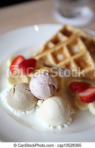 Waffles with ice cream and fruits - csp10528365