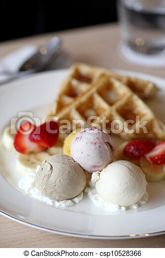 Waffles with ice cream and fruits - csp10528366