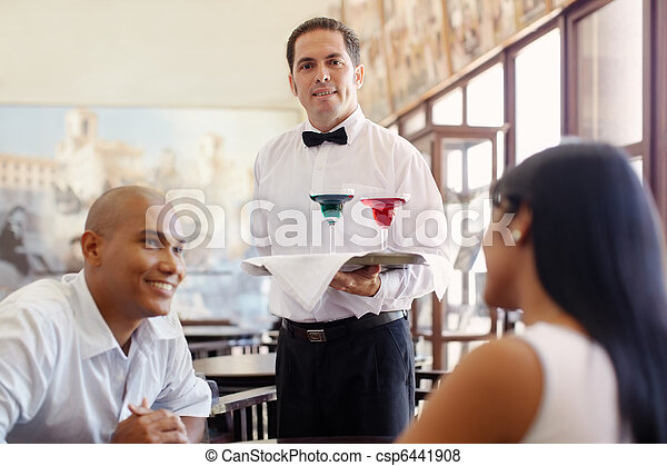 waiter standing with tray in restaurant - csp6441908