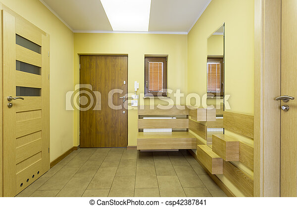 Waiting room in yellow colour. Waiting room with light yellow walls ...