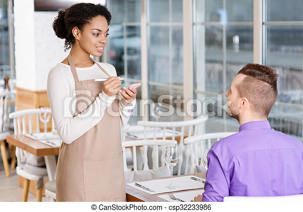 Waitress is busy taking an order