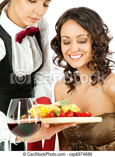 Waitress offering fruits to customer - csp6974686