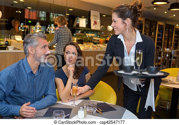Hot mature waitress serves a customer