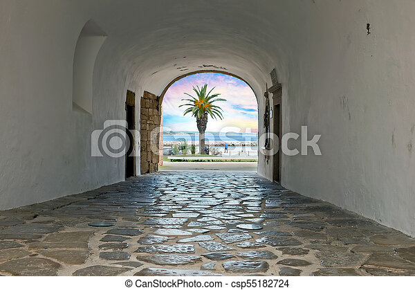 Walk through a medieval entrance to the ocean in Lagos Portugal at sunset - csp55182724
