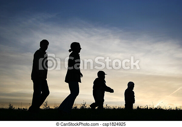 walking family of four on sky - csp1824925