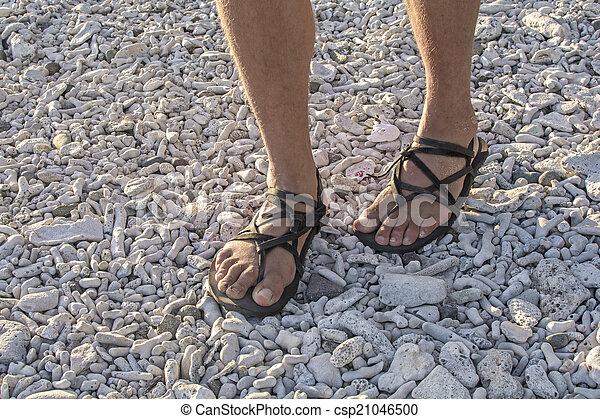 Walking in sandals on beach - csp21046500