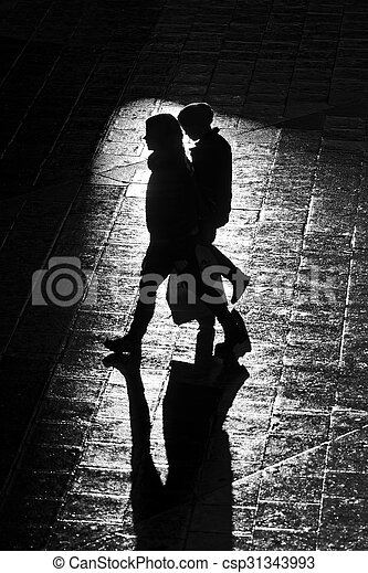 Walking persons with long shadows in high contrast - csp31343993
