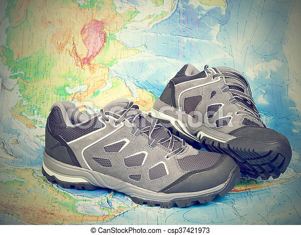 Walking trekking shoes on the world mapavel and tourism gumiabroncs Image collections