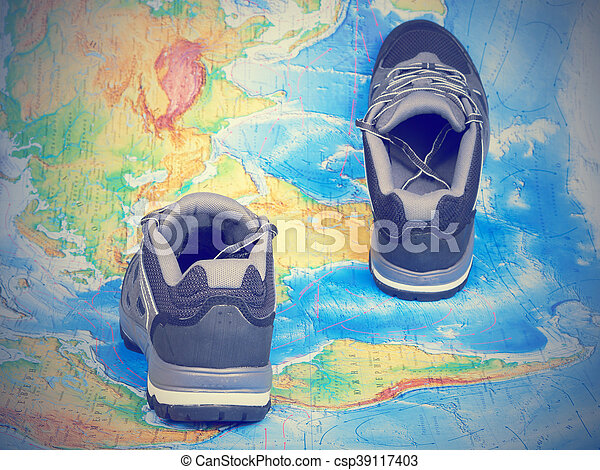 Walking trekking shoes on the world mapavel and tourism stock walking trekking shoes on the world map csp39117403 gumiabroncs Image collections