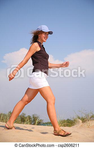 walking woman on sand - csp2606211