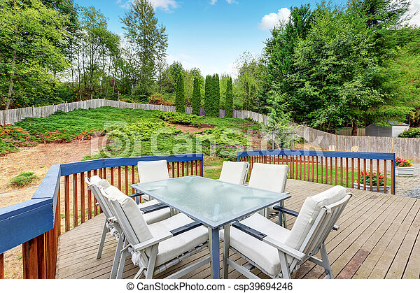 Walkout deck with railings and outdoor patio set - csp39694246