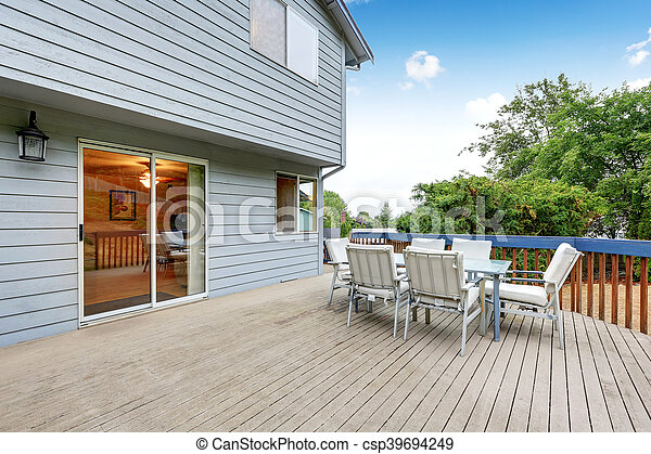 Walkout deck with railings and outdoor patio set - csp39694249