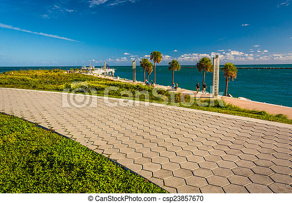 Walkway and view of the Atlantic Ocean at South Pointe Park in M - csp23857670