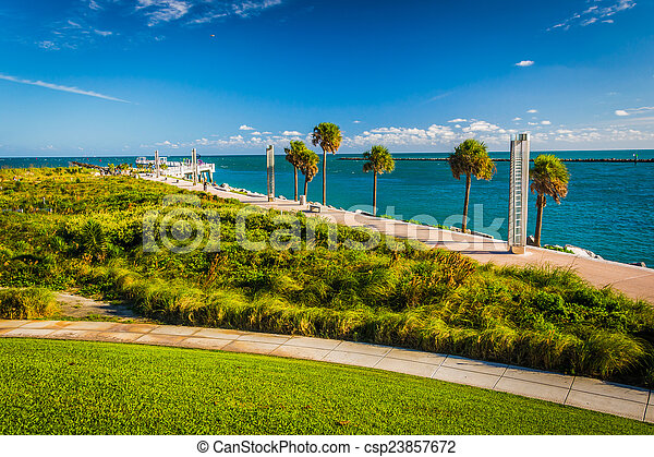 Walkway and view of the Atlantic Ocean at South Pointe Park in M - csp23857672