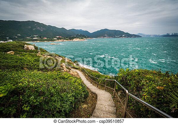 Walkway and view of the coast at Tai Tau Chau, at Shek O, on Hong Kong Island, Hong Kong. - csp39510857