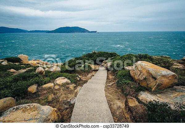 Walkway and view of the coast at Tai Tau Chau, at Shek O, on Hong Kong Island, Hong Kong. - csp33728749