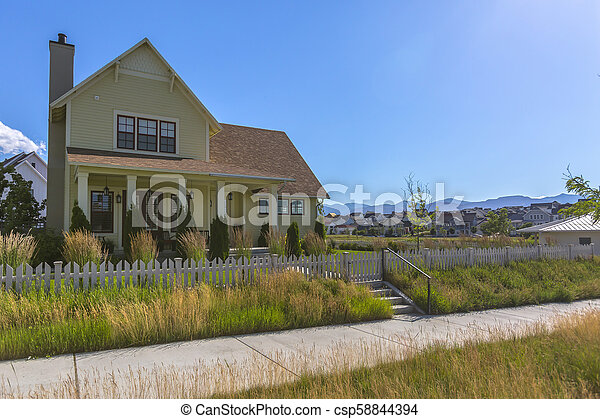 Walkway with grass on either side between homes - csp58844394