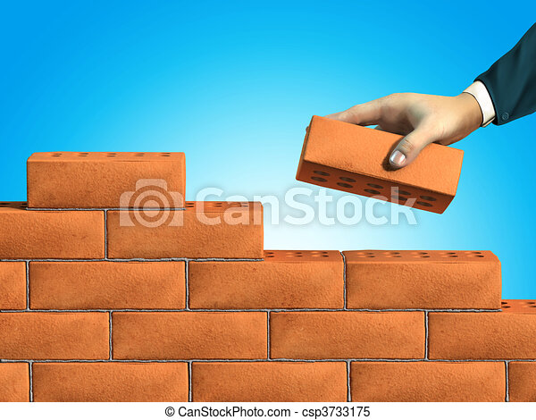Wall Building Businessman Hand Putting A Brick On New