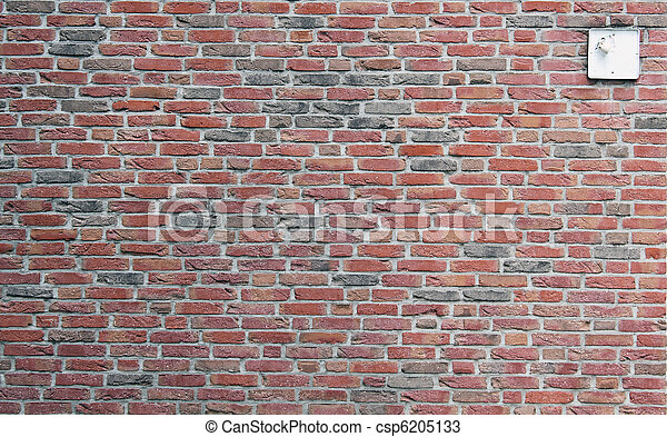 wall from a red clay brick with the broken lamp - csp6205133