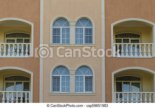 Wall of a house with windows in a classic design. - csp59651983