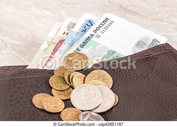 Wallet open with russian rubles banknotes and coins sticking out - csp43851187