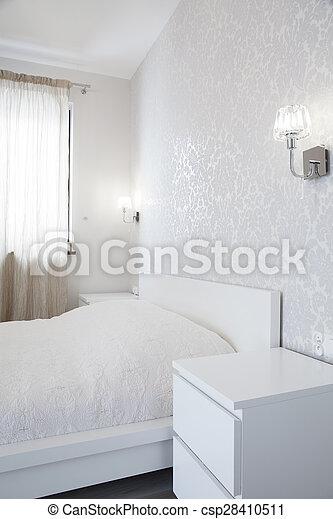 Wallpaper in bright bedroom - csp28410511