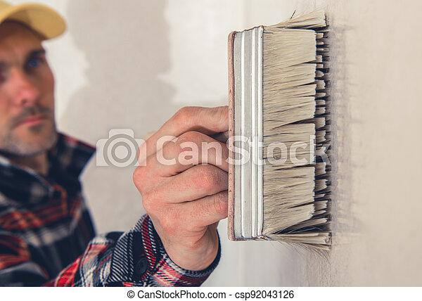 Walls Priming Using Large Painting Brush - csp92043126