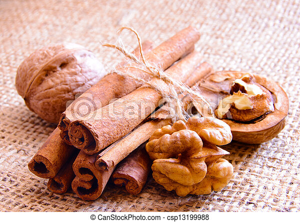 Walnuts and Cinnamon on the Burlap Background - csp13199988