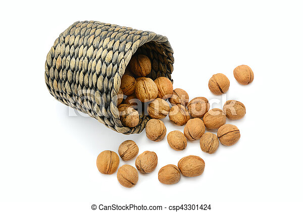 walnuts in a basket isolated on white background - csp43301424