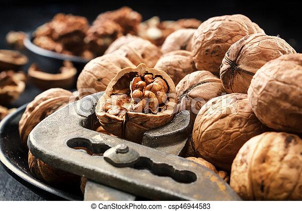 Walnuts. Nuts of walnuts. Nippers for cutting nuts - csp46944583