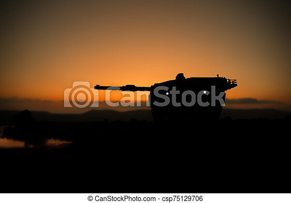 War Concept. Armored vehicle silhouette fighting scene on war fog sky background. American tank at sunset. - csp75129706